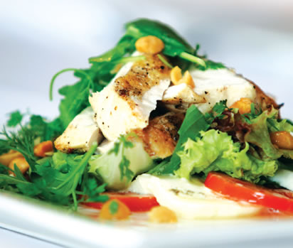 Buffalo mozzarella and tomato salad with fresh herbs and roast chicken and macadamia dressing